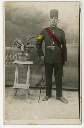 Man in uniform with fez and sash