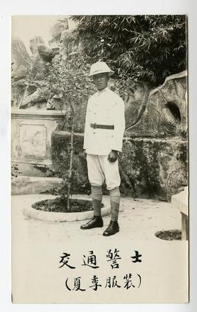 Chinese man in white uniform and hat