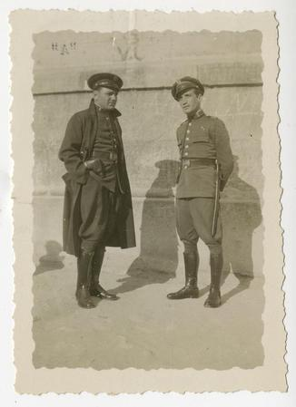 Two men in uniform with high riding boots